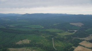 AX56_019 - 5K stock footage aerial video pass evergreen forest and wide clear cut areas in Washington County, Oregon