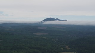 AX56_037 - 5K stock footage aerial video of Saddle Mountain, evergreen forest and logging areas in Clatsop County, Oregon