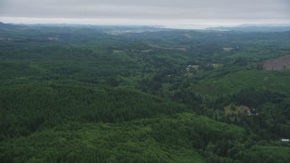 AX56_060 - 5K stock footage aerial video of flying over forest near rural areas, Clatsop County, Oregon