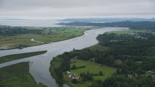 AX56_067 - 5K stock footage aerial video of farm fields around the Youngs River, Astoria, Oregon