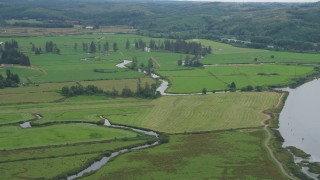 AX56_069 - 5K stock footage aerial video of farmland and small creeks beside Youngs River, Astoria, Oregon