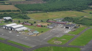 AX56_070 - 5K stock footage aerial video of Astoria Regional Airport in Astoria, Oregon