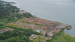 AX56_075 - 5K stock footage aerial video approach lumber yard beside the Columbia River in Warrenton, Oregon