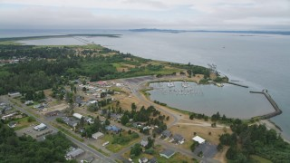 AX56_078 - 5K stock footage aerial video fly over homes, an RV park, and Hammond Marina beside the Columbia River in Warrenton, Oregon