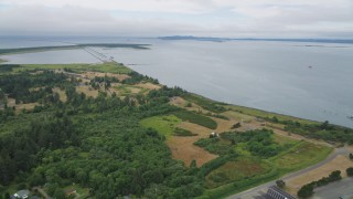 AX56_079 - 5K stock footage aerial video approach Fort Stevens beside the Columbia River in Oregon