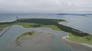 AX56_081 - 5K stock footage aerial video approach Clatsop Spit, Oregon beside the Columbia River