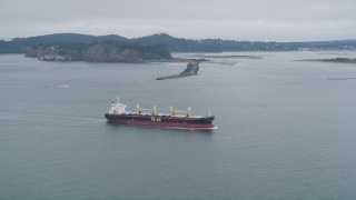 AX56_085 - 5K stock footage aerial video track oil tanker on the Columbia River near Cape Disappointment, Washington