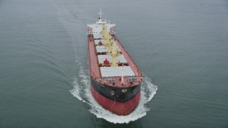 AX56_086 - 5K stock footage aerial video of tracking an oil tanker sailing on the Columbia River near Cape Disappointment, Washington