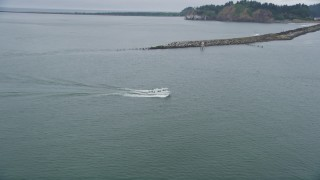 AX56_087 - 5K stock footage aerial video approach and track a fishing boat sailing on the Columbia River near Cape Disappointment, Washington