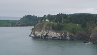 AX56_088 - 5K stock footage aerial video approach Cape Disappointment Light on cliffs in Washington