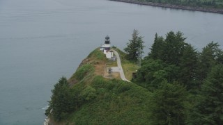 AX56_096 - 5K stock footage aerial video of Cape Disappointment Light overlooking the ocean in Washington