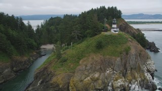 AX56_098 - 5K stock footage aerial video of the Cape Disappointment Light on top of steep cliffs in Washington