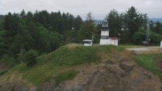 AX56_099 - 5K stock footage aerial video approach and track the Cape Disappointment Light on top of a steep cliff in Washington