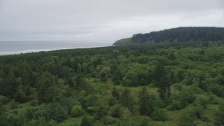 AX56_103 - 5K stock footage aerial video fly over Cape Disappointment State Park toward North Head Light, Ilwaco, Washington