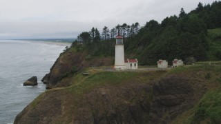 AX56_107 - 5K stock footage aerial video approach the North Head Light on top of an oceanside cliff, Ilwaco, Washington