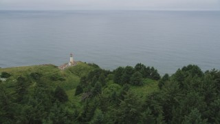 AX56_115 - 5K stock footage aerial video fly by North Head Light, Pacific Ocean, Ilwaco, Washington