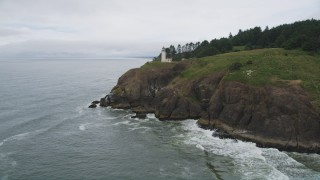 AX56_118 - 5K stock footage aerial video approach the North Head Light on a steep cliff in Ilwaco, Washington