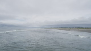 AX56_128 - 5K stock footage aerial video of ocean waves near a beach in Seaview, Washington