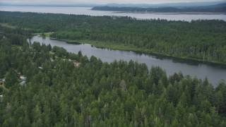 AX56_146 - 5K stock footage aerial video approach lakeside homes with docks on Loomis Lake, Washington