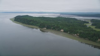 AX56_148 - 5K stock footage aerial video approach the green shore and trees on Long Island, Washington