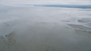 AX56_153 - 5K stock footage aerial video of a view of Willapa Bay, Washington from wetlands on the shore