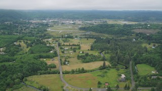 AX56_173 - 5K stock footage aerial video of small farms around Fowler Road by the Willapa River near the small town of Raymond, Washington
