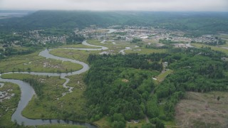 AX56_175 - 5K stock footage aerial video of small town of Raymond, Washington beside the Willapa River