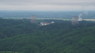 AX57_009 - 5K stock footage aerial video of Satsop Nuclear Power Plant cooling towers surrounded by forest, Satsop, Washington