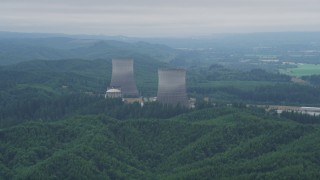 AX57_012 - 5K stock footage aerial video of a pair of cooling towers at the Satsop Nuclear Power Plant, Satsop, Washington