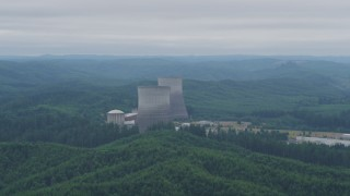 AX57_013 - 5K stock footage aerial video of two cooling towers at the Satsop Nuclear Power Plant, Satsop, Washington