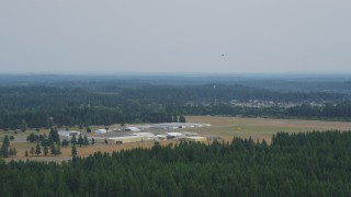 AX57_036 - 5K stock footage aerial video of a view of Sanderson Field airport, Shelton, Washington