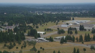 AX57_037 - 5K stock footage aerial video of Sanderson Field airport hangars in Shelton, Washington