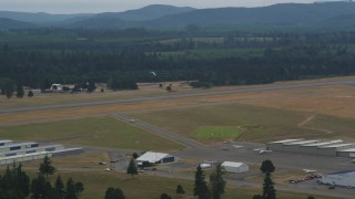 AX57_039 - 5K stock footage aerial video of skydiver coming in for a landing at Sanderson Field airport, Shelton, Washington