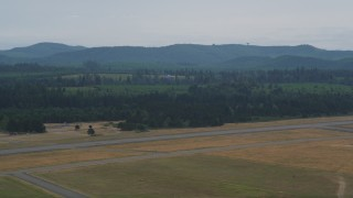 AX57_040 - 5K stock footage aerial video of a skydiver landing at Sanderson Field in Shelton, Washington