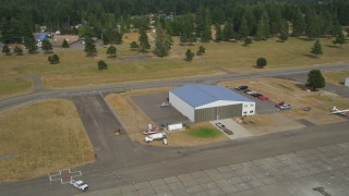 AX58_001 - 5K stock footage aerial video of a small hangar and fuel truck at Sanderson Field airport, Shelton, Washington