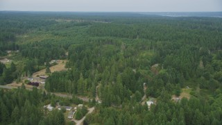 AX58_028 - 5K stock footage aerial video fly over rural homes on the edge of an evergreen forest in Vaughn, Washington