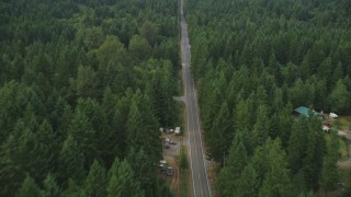 AX58_031 - 5K stock footage aerial video of following Wright Bliss Road past a few rural homes in Gig Harbor, Washington