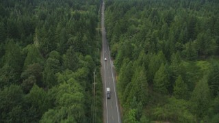 AX58_032 - 5K stock footage aerial video of Wright Bliss Road through evergreen forest in Gig Harbor, Washington