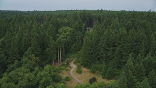 AX58_055 - 5K stock footage aerial video approach an isolated home in the woods on Vashon Island, Washington