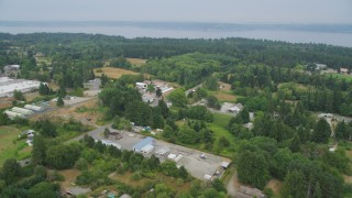 AX58_061 - 5K stock footage aerial video fly over small farms, fields, and shops around Cemetery Road on Vashon Island, Washington