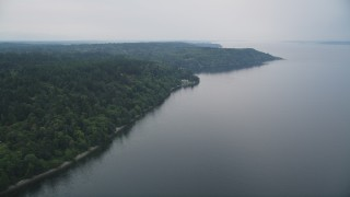 AX58_064 - 5K stock footage aerial video of evergreen forest covering the shore of Vashon Island, Washington