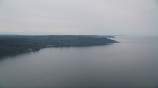 AX58_065 - 5K stock footage aerial video fly away from Vashon Island, seen from Puget Sound, Washington