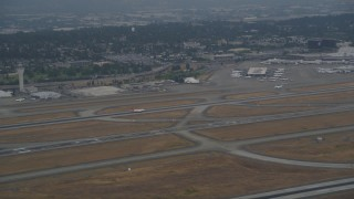 AX58_071 - 5K stock footage aerial video track airliner taking off from Seattle Tacoma International Airport, Seattle, Washington