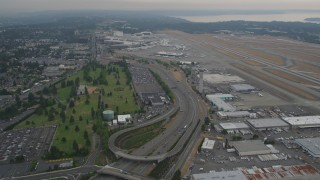AX58_073 - 5K stock footage aerial video of light traffic on Airport Expressway by Seattle Tacoma International Airport, Seattle, Washington