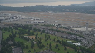 AX58_074 - 5K stock footage aerial video of runways and control tower at Seattle Tacoma International Airport, Seattle, Washington