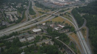 AX58_075 - 5K stock footage aerial video fly by office buildings and the I-405 / I-5 interchange, Tukwila, Washington