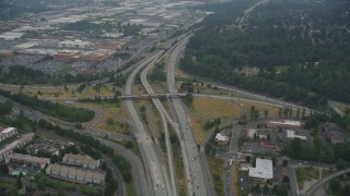 AX58_076 - 5K stock footage aerial video of I-405 / I-5 interchange with light traffic in Tukwila, Washington