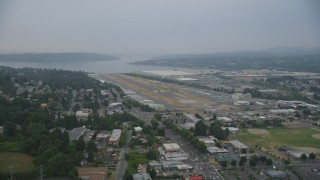 AX58_080 - 5K stock footage aerial video approach the runway at the Renton Municipal Airport, Washington