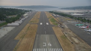 AX58_081 - 5K stock footage aerial video approach the Renton Municipal Airport runway in Washington