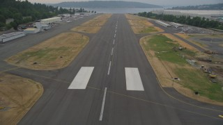 AX58_082 - 5K stock footage aerial video of descending for a landing at Renton Municipal Airport, Washington